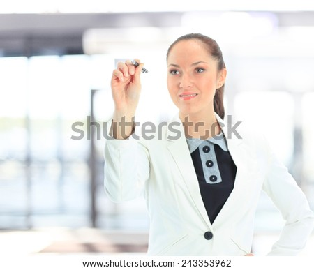 Young businesswoman drawing graph or chart - stock photo