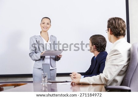 Young businesswoman giving a presentation to her colleagues - stock photo