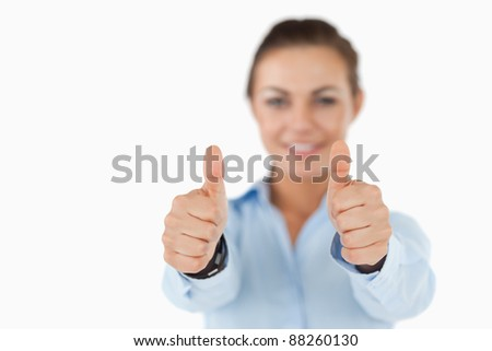 Young businesswoman giving approval against a white background - stock photo