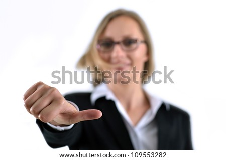 Young businesswoman hand gesturing thumbs up success sign - stock photo