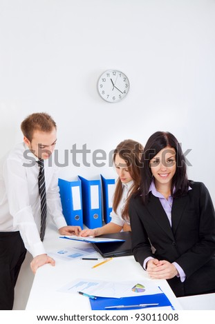 young businesswoman happy smile at office, colleagues on background people working, business man and woman discussing the problem, business plan, papers charts, document, businesspeople above top view - stock photo