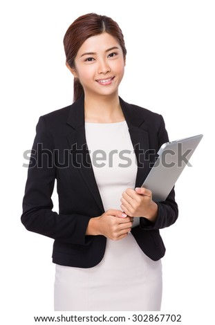 Young businesswoman hold with laptop computer - stock photo