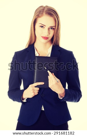 Young businesswoman holding a note - stock photo