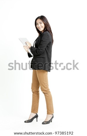 Young businesswoman holding her laptop on isolated background