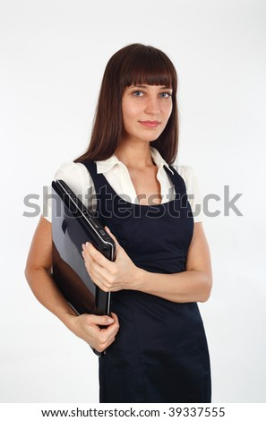 young businesswoman holding her notebook computer underarm - stock photo