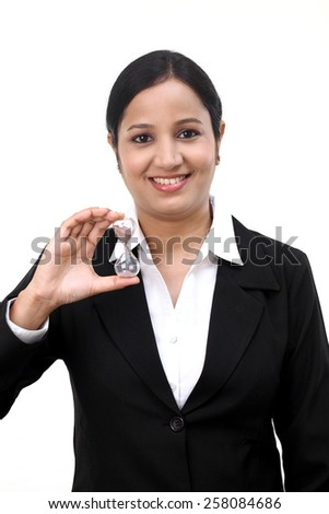 Young businesswoman holding hourglass