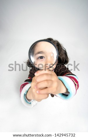 Young businesswoman holding Magnifying Glass, business photo - stock photo