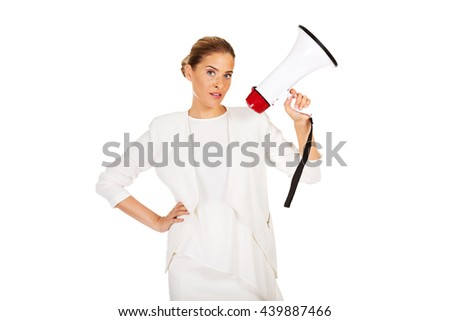 Young businesswoman holding megaphone - stock photo
