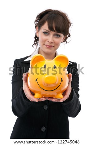 Young businesswoman holding piggybank - stock photo