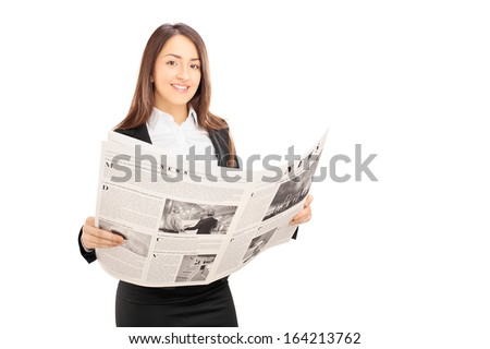 Young businesswoman in black suit holding a newspaper isolated on white background - stock photo