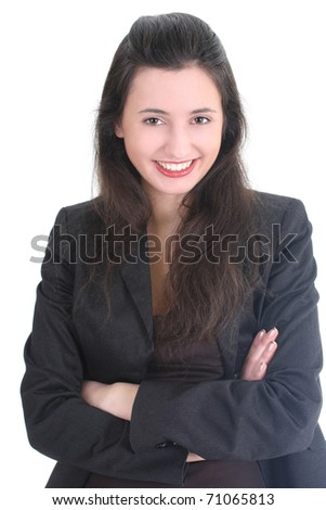Young businesswoman in black suit smiling over white - stock photo