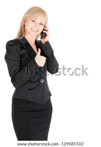 Young businesswoman in black  with smartphone posing over white background. - stock photo