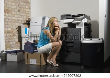 Young Businesswoman in Copy Room - stock photo