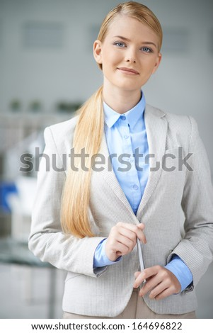 Young businesswoman in formalwear looking at camera - stock photo