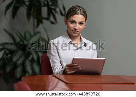 Young Businesswoman In Formalwear Working On Digital Tablet And While Working In The Office - Successful Business Woman At Work