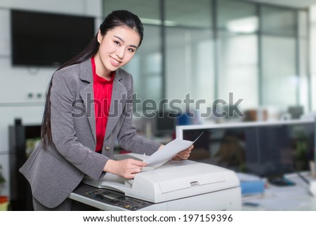 young businesswoman in her office, asia girl. - stock photo