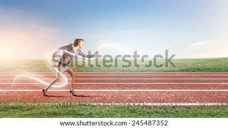 Young businesswoman in start position ready to run