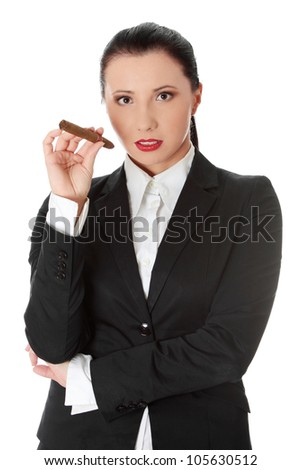 Young businesswoman is holding cigar. Isolated on the white background. - stock photo