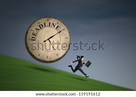 Young businesswoman is running out of deadline outdoor - stock photo