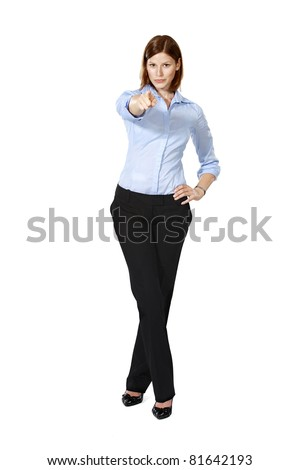 Young businesswoman isolated on a white background standing and pointing ahead as she wants you - stock photo