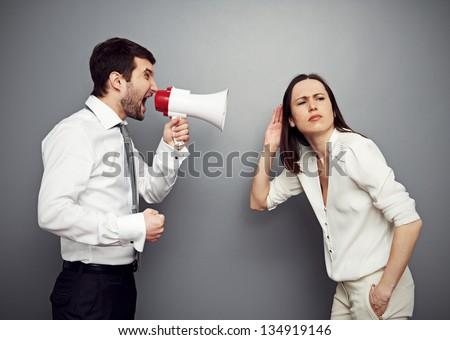 young businesswoman listening her angry boss - stock photo