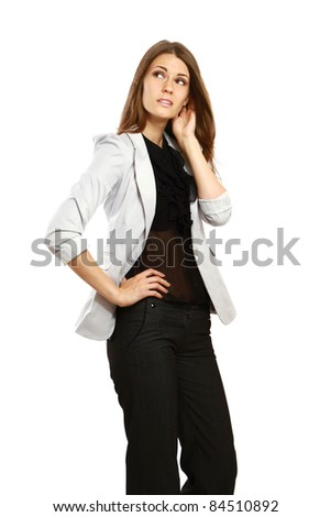 Young businesswoman looking at copyspace, hard decision, studio shoot isolated on white background