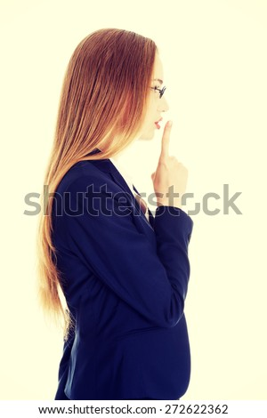 Young businesswoman making silent gesture - stock photo