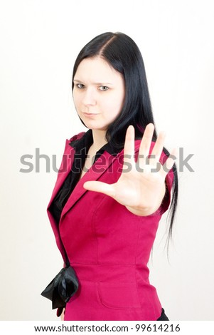 Young businesswoman making Stop gesture - stock photo