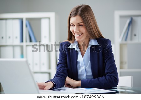Young businesswoman networking in office - stock photo