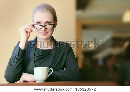 Young businesswoman on a coffee break