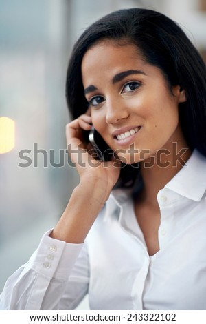 young businesswoman on phone call in office happy and smiling