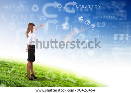 Young businesswoman outdoor with business symbols on the sky background - stock photo