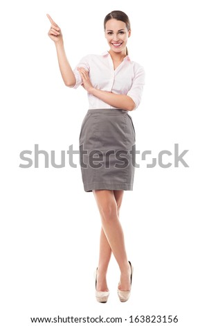 Young businesswoman pointing  - stock photo