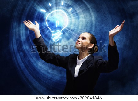 Young businesswoman praying on light bulb. Problem solution - stock photo