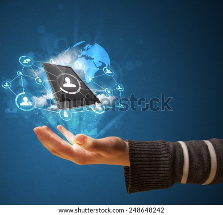 Young businesswoman presenting cloud technology in her hand - stock photo