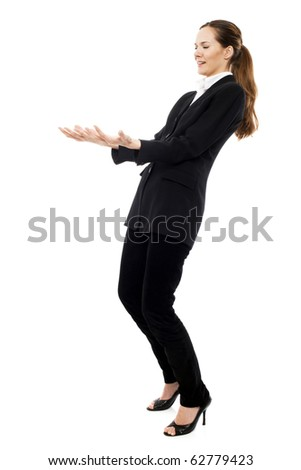 Young businesswoman pretending to carry a weight on white background studio