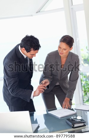 Young businesswoman providing pen to sign contract - stock photo