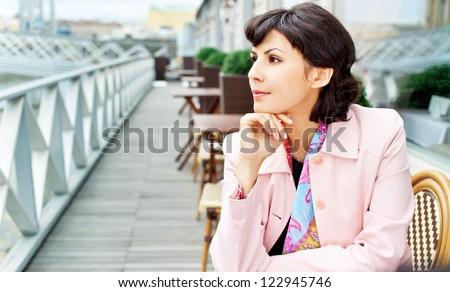 Young businesswoman relaxing outdoor - stock photo