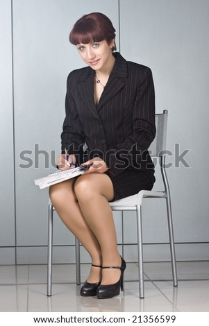 Young businesswoman, secretary or student with pen - stock photo