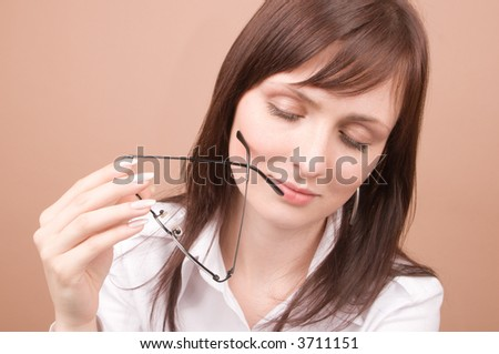 Young businesswoman serious looking isolated on beige background