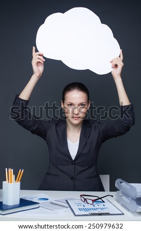 Young businesswoman showing blank speech bubble - stock photo