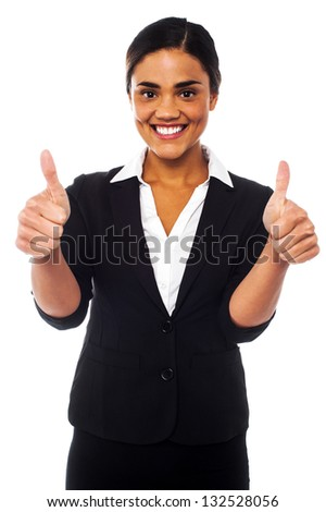 Young businesswoman showing double thumbs up to the camera. - stock photo