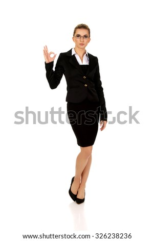 Young businesswoman showing perfect sign. - stock photo