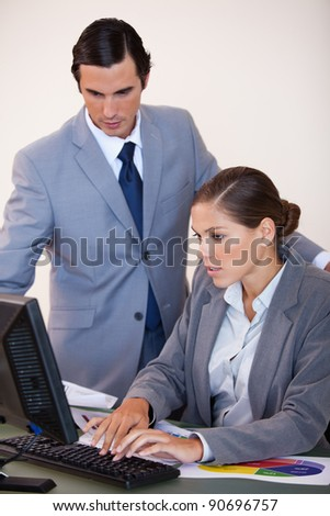 Young businesswoman showing screen to her colleague