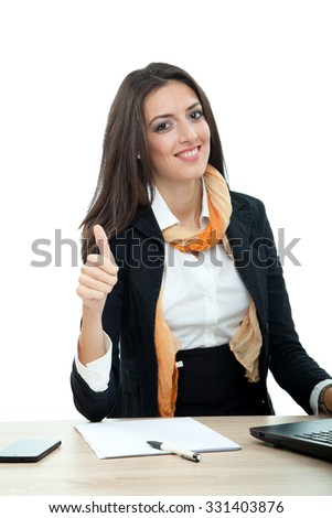 Young businesswoman showing thumbs up symbol - stock photo
