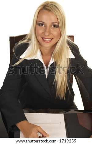 Young businesswoman signing contract