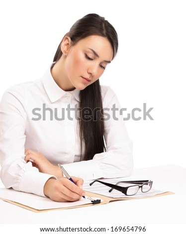 Young businesswoman signing documents at desk isolated on white background
