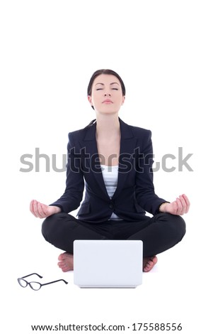 young businesswoman sitting in yoga pose with laptop isolated on white background - stock photo