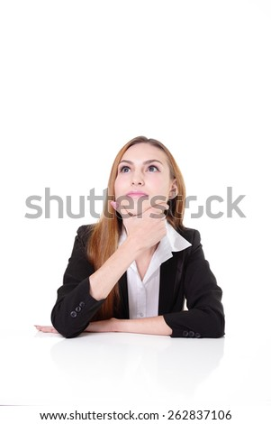 Young businesswoman sitting on the desk thinking something. Isolated on white background. caucasian beauty - stock photo