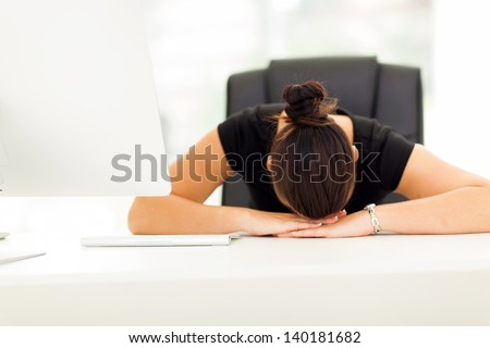 young businesswoman sleeping in her office - stock photo